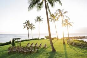 Outdoor wedding ceremony under palm trees