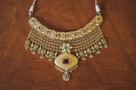 Medallion and pendant with colorful jewels for Indian bride