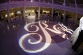 Gobo lighting with initials on dance floor