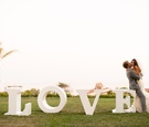 Southern California bride and groom next to LOVE letters