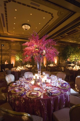 Round table with orchid tree centerpiece