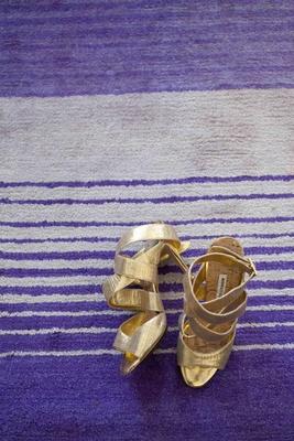 Bride's golden Manolo Blahnik sandal pumps