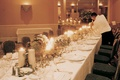 Long rectangular table decorated with white and green decorations