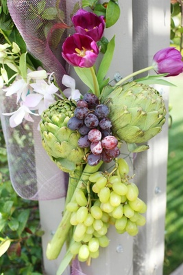 Wedding ceremony structure flower and fruit arrangement