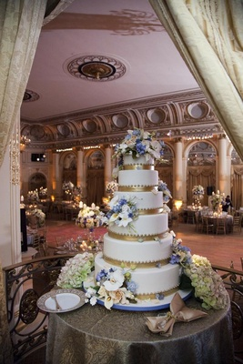 Ron Ben-Israel wedding cake with gold bands, beading, and fresh flowers