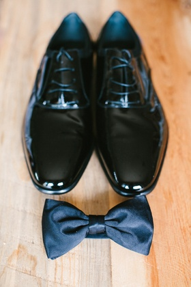 Patent leather shoe with laces and black bow tie