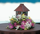 brown lantern and colorful flowers on table