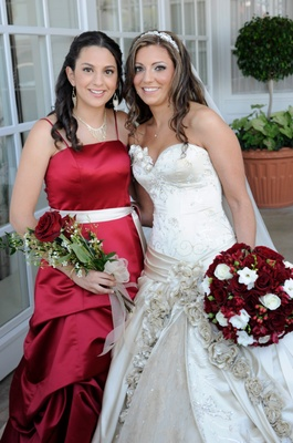 Bride with bridesmaid in red bridesmaid dress