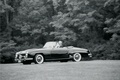 Black and white photo of classic convertible wedding car 1958 Mercedes