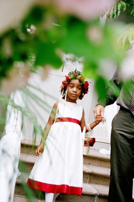 African American flower girl wearing rose floral crown