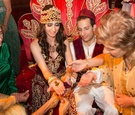 Bride and groom with henna on palm of hands