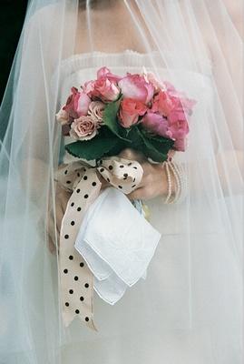 Polka dot ribbon tied flower bouquet