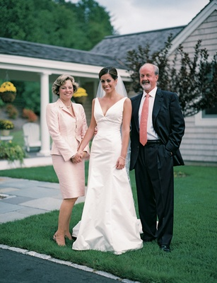 Bride with dad and mom in light pink two-piece suit