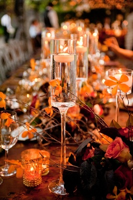 Champagne flute-shaped vases filled with candles