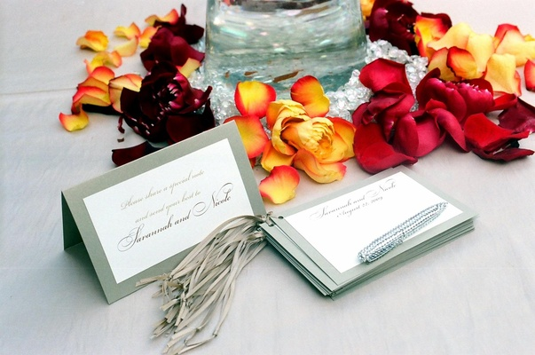 Silver-bordered card tied with ribbon