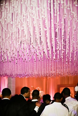 Crystals and ribbon dangling from reception ceiling