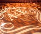Monogrammed dance floor with projection lighting