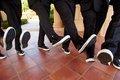 Groomsmen in patent leather Chuck Taylors
