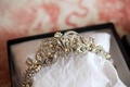 Bride's silver-tone tiara with rhinestones and pearls