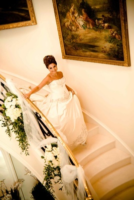 Princess bride walking down long staircase