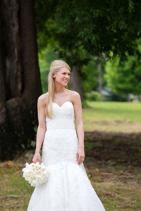 Bride in strapless, lace, fit-and-flare wedding dress