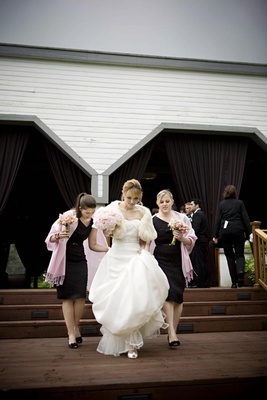 bridesmaids wearing black dresses and pink pashminas