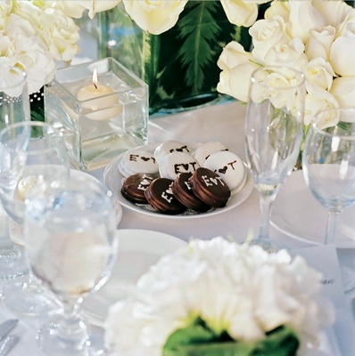 monogrammed chocolate oreos on table surrounded by flowers