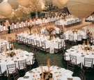 Round and rectangular tables and ivory lanterns