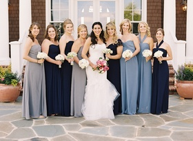 Bride with bridesmaids in different dresses
