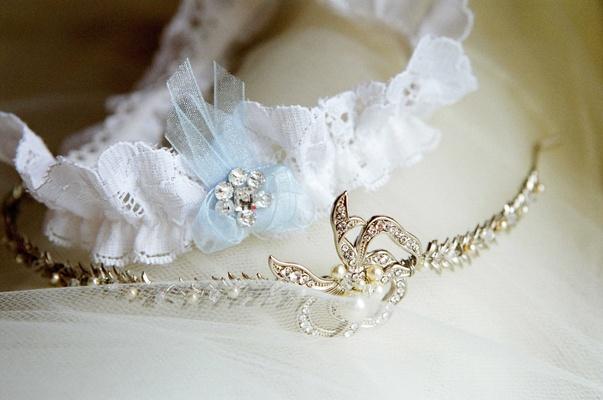 Lace garter next to gold and diamond tiara