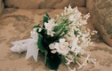 White and ivory flowers tied with ribbon