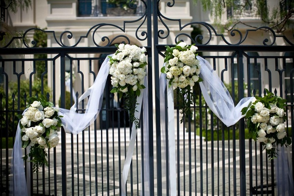 Wrought-iron gate decorated with white flowers