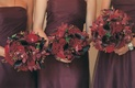 Bridesmaid bouquets in red and burgundy