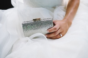 Bride holding structured purse with snakeskin design