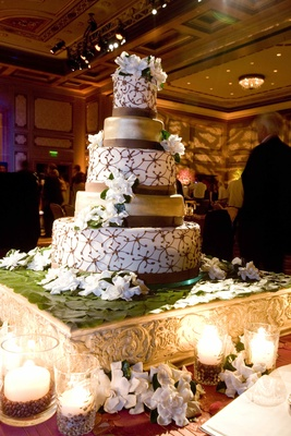 Five layer cake with gardenias and ribbons