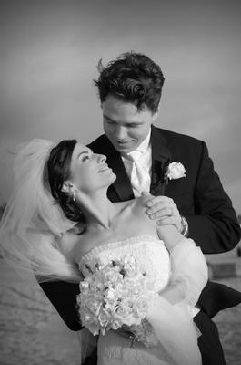 Black and white photo of newlyweds on beach