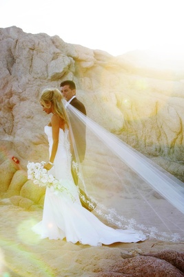 strapless gown with cathedral veil at sunset