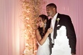 Basketball player Joshua Smith and bride next to cake