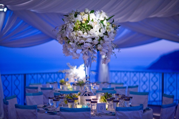 White billowing fabric tent and ocean view