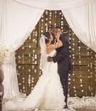 Tennessee Titan Jason McCourty in black tuxedo kisses bride in Mark Zunino dress at ceremony