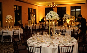 Wedding reception with white flowers and linens at a ballroom in Bella Collina, Montverde, FL