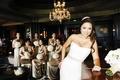 Asian American women in hotel lounge in scoop dresses