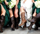 Bridesmaids and bride at rustic wedding with cowboy boots