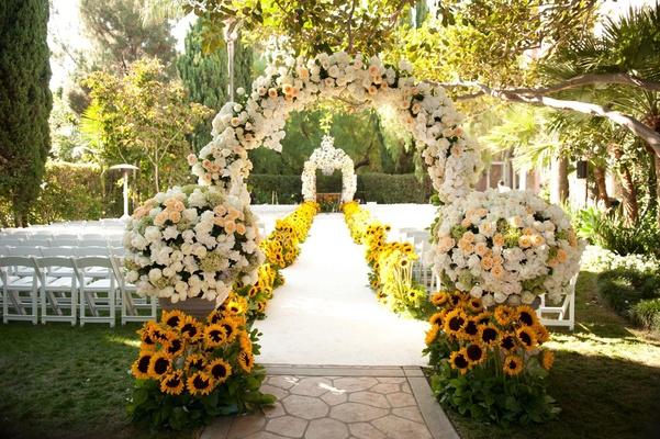 Summer sunflower ceremony garden inspired reception for Home garden wedding decorations